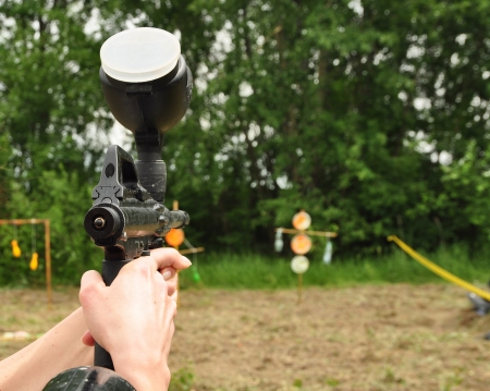 gunfire: Paintball player aiming with marker