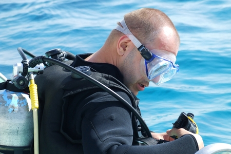 scuba diver on boat before diving