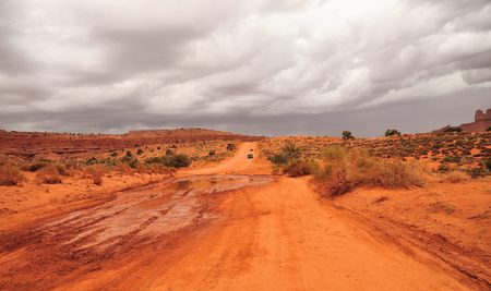 navajo land: mudden road in monument valley Stock Photo