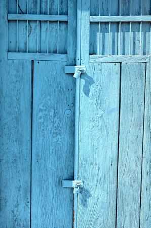 padlock on blue door photo