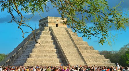 CHICHEN ITZA, MEXICO - MARCH 21,2014: Tourists watching the feathered serpent crawling down the temple (Equinox March 21 2014)
