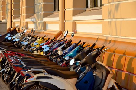 congested: rows of motorbikes parked outside a public building in Ho Chi Minh City Stock Photo