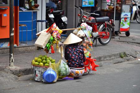 hard sell: Unidentified street vendor on street in a Saigon Vietnam Editorial