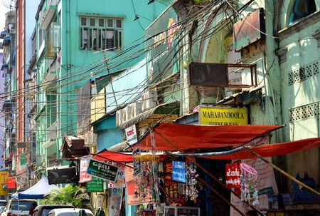archtecture: Yangon, Myanmar - March 9, 2015: A street archtecture view with colonial building in the town of Yangon