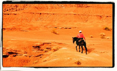 west usa: Man on a horse on wild west USA Stock Photo