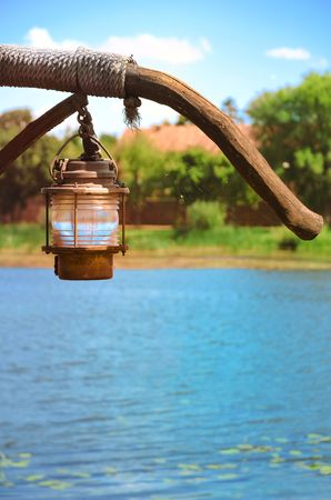 spiders web: old sailor lantern on water surface with spiders web