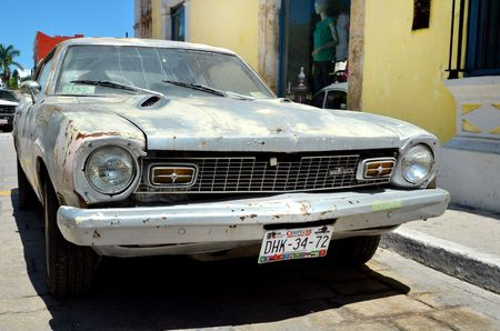 marion: Campeche, Mexico - February 18, 2014: A street in Campeche with damage old Maverick car Editorial