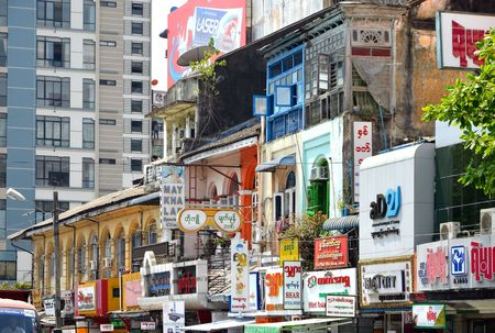 colonial building: Yangon, Myanmar - March 9, 2015: A street archtecture view with colonial building in the town of Yangon