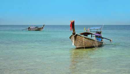 aonang: KRABI, THAILAND - MARCH 18, 2015: Long boats in andaman sea in summer vacation Editorial