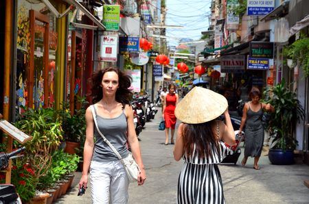 min: Woman on street of Saigon (Ho Chi Min City) full of wires.