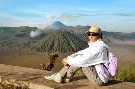 Woman on the top near volcano Bromo in Indonesia
