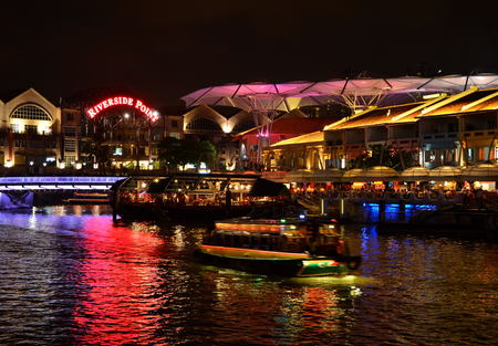 Colorful light building at night in Clarke Quay Stock Photo