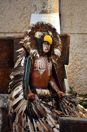 CHICHEN ITZA, MEXICO - MARCH 21,2014:Native mayan dancers performing in the Chichen Itza Editorial
