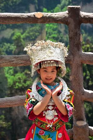 Zhangjiajie, China - May 12, 2017: Little girl in traditional chinese clothes in Wulingyuan Zhangjiajie National Park, China