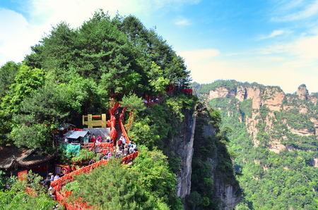 Zhangjiajie, China - May 10, 2017: Path with red ribbons Zhangjiajie National Park, China.