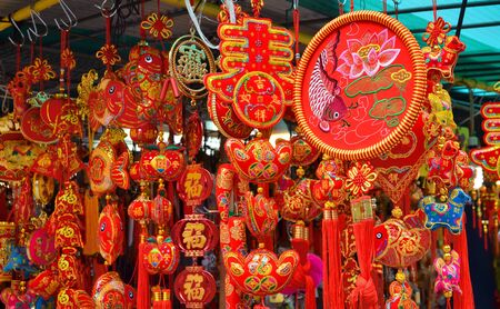 Hong Kong-February 5, 2019: People are seen choosing the Chinese New Year decorations at the stalls outside Wong Tai Sin Temple on the first day of Chinese New Year.