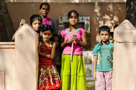 group of indian poor kids with mother looking at camera. 11 february 2018 Puttaparthi, India Redakční