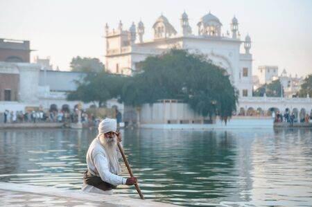old sikh cleans a lake nearby golden temple. 26 february 2018 Amritsar, India