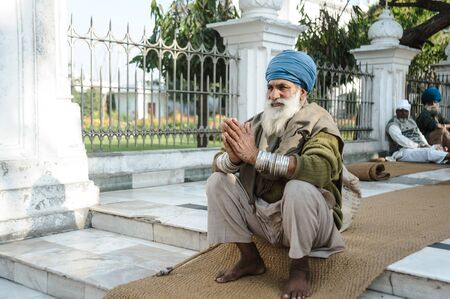old indian sikh praying nearby golden temple. 26 february 2018 Amritsar, India. Editorial