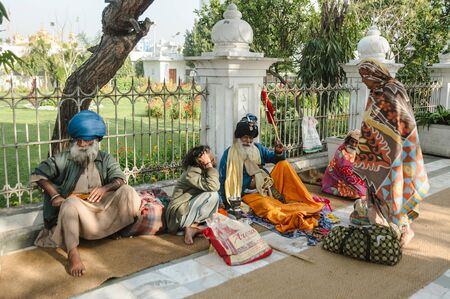 group of indian sikhs sits nearby golden temple. 26 february 2018 Amritsar, India. Editorial