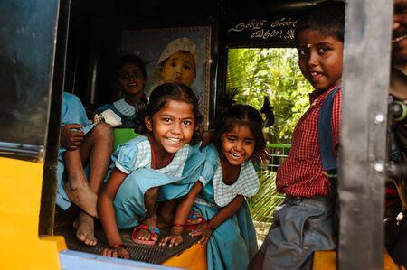 23 february 2018 Madurai, India, group of indian schoolgirls smiling to camera in tuk tuk rickshaw