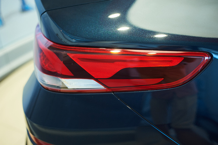red tail lights of blue car closeup. auto car showroom Stock Photo
