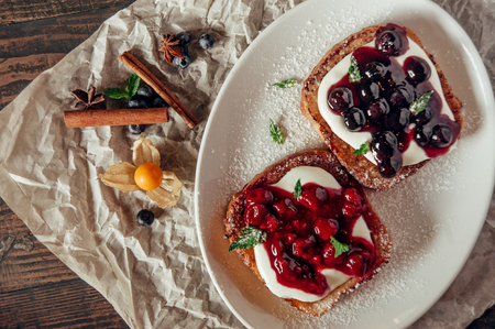 sweet toast with berry jam at paper background