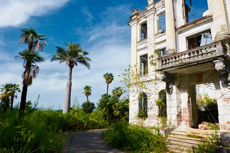 Abandoned Palace of Prince Smetsky in beautiful tropic palm garden. built in 1913, Abkhazia. Overgrown house