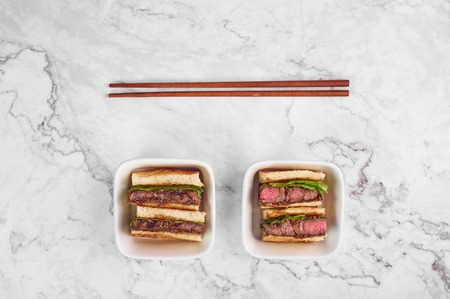 sandwich katsu sando with beef steak. wagyu katsu. japanese cuisine traditional food. Trendy healthy fast food at marble background Banque d'images - 122481260