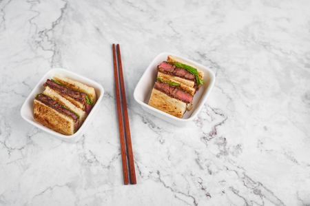 sandwich katsu sando with beef steak. wagyu katsu. japanese cuisine traditional food. Trendy healthy fast food at marble background