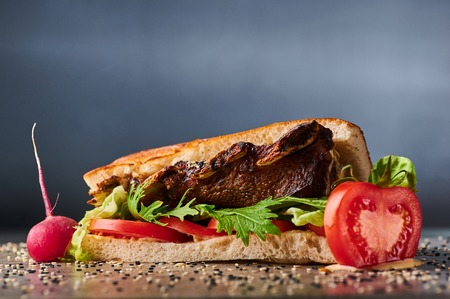 big giant sandwich witch grilled pork ribs in ciabatta. Copy space Stock Photo