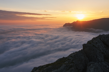 beautiful sunset above the clouds in the mountains. stunned landscape background with copy space. aerial mountain view Imagens