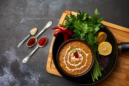 Dal Makhani at dark background. Dal Makhani - traditional indian cuisine puree dish with urad beans, red beans, butter, spices and cream.