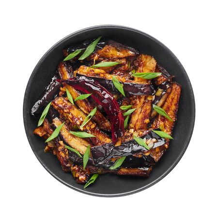 Sichuan Eggplant Stir Fry isolated at white background. Eggplant Stir Fry is chinese cuisine dish with deep fried eggplant, chilli pepper, different sauces. Top view