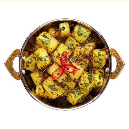 Aloo Methi in copper kadai, bowl isolated at white background. Aloo Methi is indian cuisine dish with Potato, Fenugreek and Spices. Indian Food. Isolate