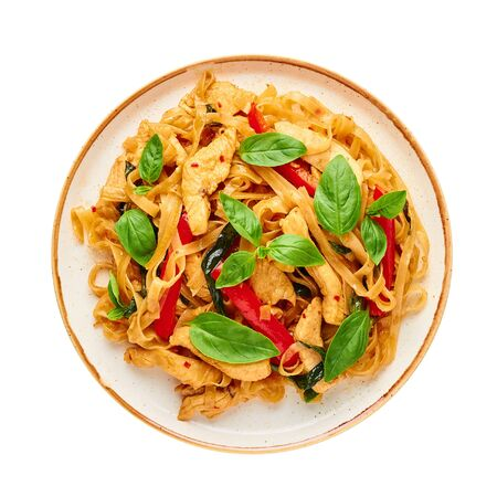 Thai Drunken Noodles or Pad Kee Mao isolated on white . Drunken Noodles is thai cuisine dish with Rice Noodles, Chicken meat, Basil, sauces and vegetables. Thai Food
