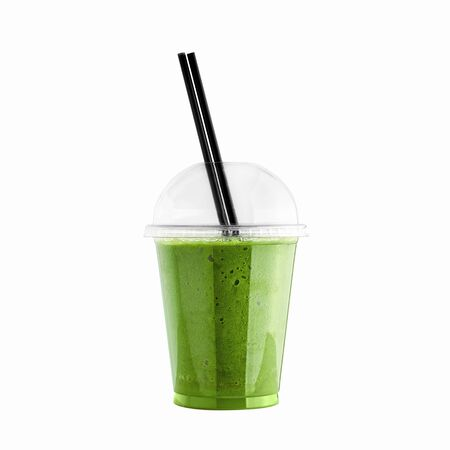 Green kiwi smoothie in plastic cup with straw isolated on white background. Kiwi or green vegetable healthy beverage. Detox drink.