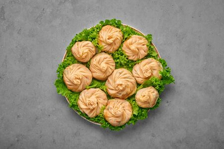 Veg Momos on gray concrete table top . Momos is the popular dish of indian, tibetan, chinese cuisines. Asian food. Vegetarian meal. Top view
