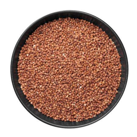 Raw buckwheat groats in black bowl isolated on white. Healthy vegetarian organic food ingredient