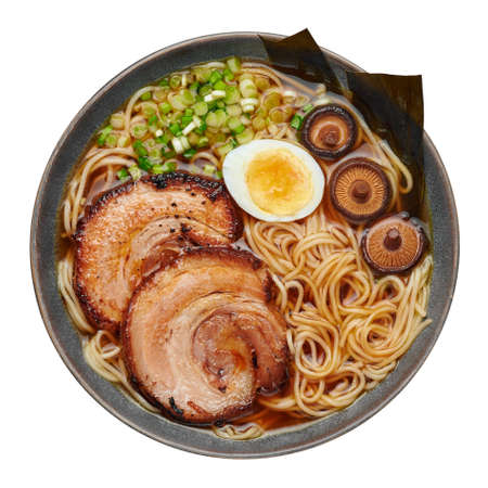 A Shoyu Ramen in gray bowl isolated on white. Japanese cuisine meat noodle soup with chashu pork. Asian food. Top view