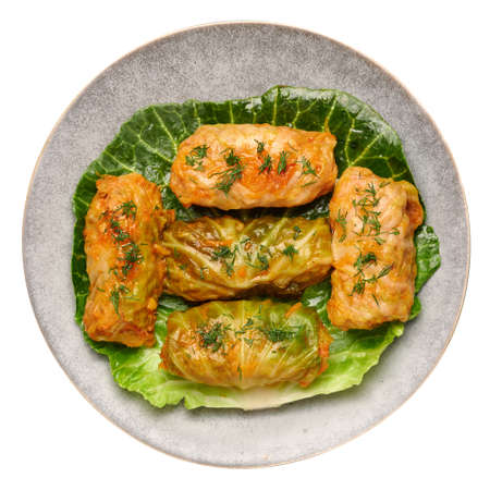 Golubtsi or golabki on gray plate isolated on white. Stuffed cabbage rolls dish of russian, polish, ukrainian cuisine. European food. Banque d'images