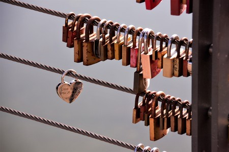 A love lock is a padlock attached to bridges, grids, according to a custom of lovers. This is to symbolically seal their eternal love.