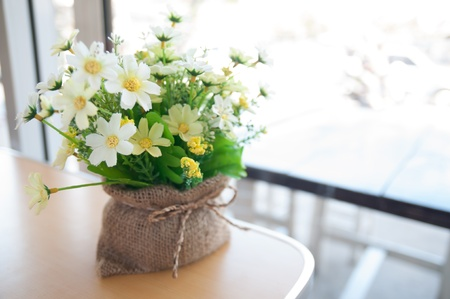 Sunny morning with flowers in cafe