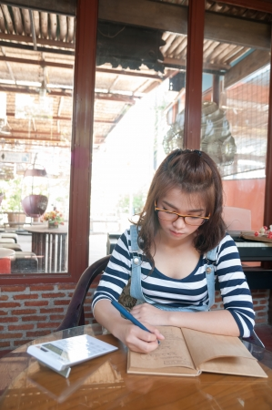 One Woman some taking notes in sunny day photo