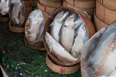 Fresh Mackerel on bamboo baskets to sell in the market photo