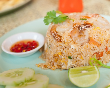 Rice were fried in oil with shrimp and vegetables. photo