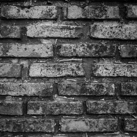 The surface of the brick walls cracked photo