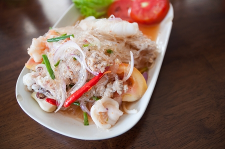 This menu is a combination of pork with vermicelli and salad. photo