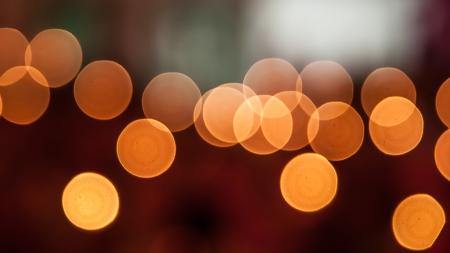 Orange bokeh light of many candles in religious ceremonies Stock Photo