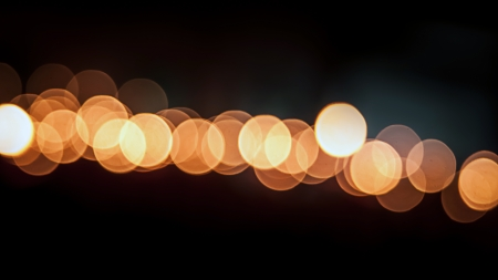 Orange bokeh light of many candles in religious ceremonies photo